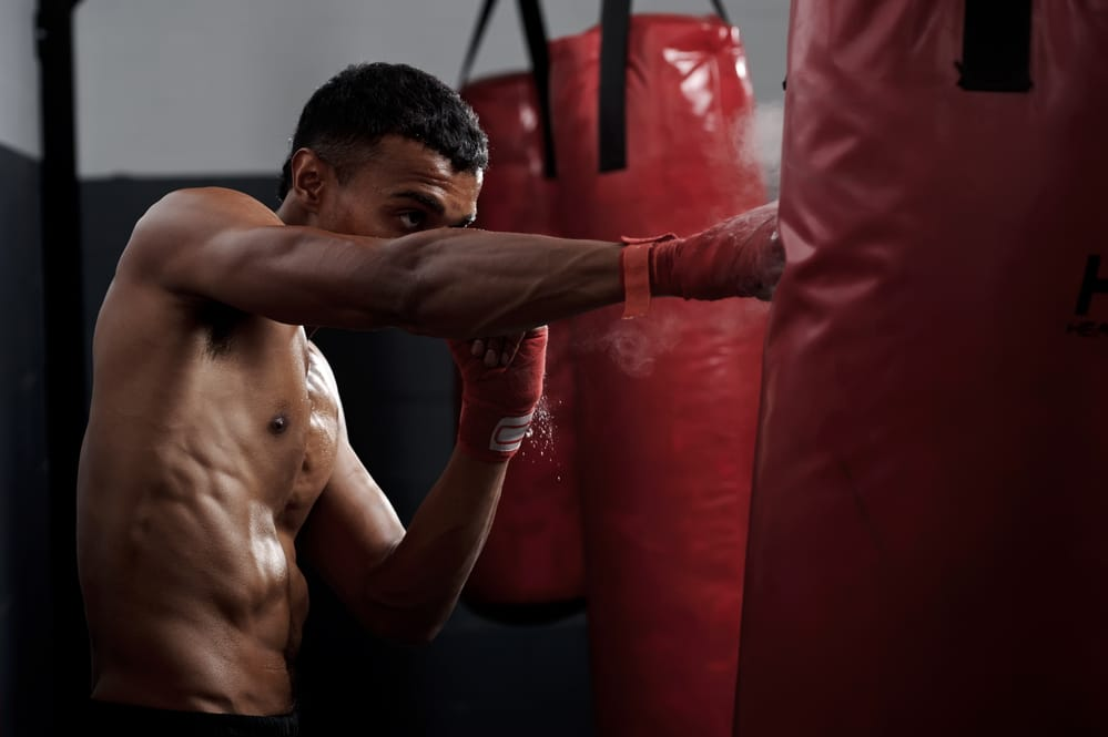 A boxer punches with force